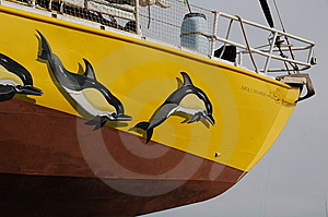 Bow Of Yacht With Painted Dolphins Royalty Free Stock Image - Image: 8621916