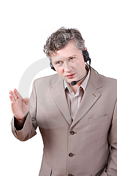 Businessman Is Speaking Over The Headset Stock Photography - Image: 8623812
