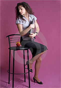 Brunette Girl Sitting Full-length. Royalty Free Stock Photos - Image: 8625148