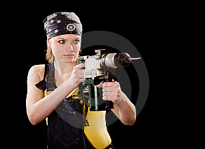 Severe Young Woman With A Drill Stock Image - Image: 8625511