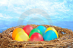 Color Eggs In A Golden Nest Stock Images - Image: 8626884