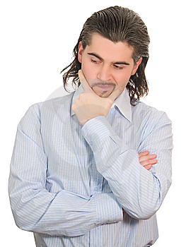 Young Unhappy Man Holds Hand At Chin And Thinks Stock Photo - Image: 8627830