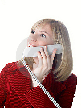 The Girl Speaks On The Phone Royalty Free Stock Photo - Image: 8629435