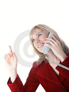 The Girl Speaks On The Phone Royalty Free Stock Photography - Image: 8629447