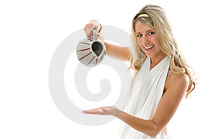 The Young Attractive Girl Pours Milk From A Jug Stock Images - Image: 8631054