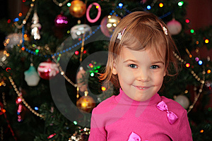 Christmas Fir And Little Girl Royalty Free Stock Image - Image: 8631136