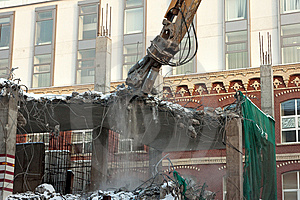 Heavy Dredger Demolishes Building Stock Photos - Image: 8631443
