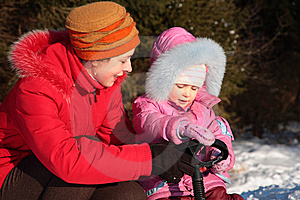 Mother And Daughter With Snow Scooter Stock Photos - Image: 8631543