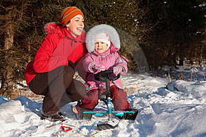 Mother And Daughter With Snow Scooter Royalty Free Stock Images - Image: 8631559