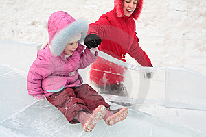 Girl Rolls Down On Ice Slope With Mother Stock Image - Image: 8632181