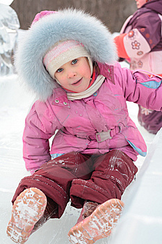 Girl Rolls Down On Ice Slope Royalty Free Stock Images - Image: 8632199