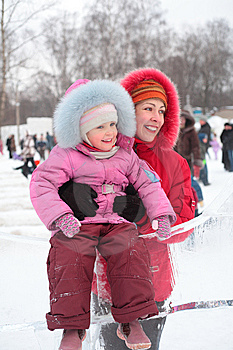 Girl On Ice Slope With Mother Royalty Free Stock Photo - Image: 8632215