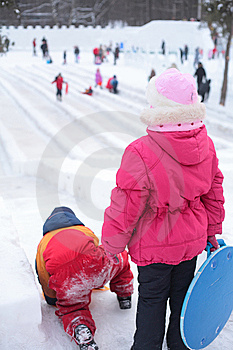 Children On Ice Slope In Park Stock Photo - Image: 8632230