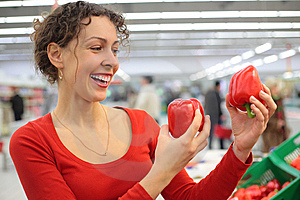 Woman In Shop With Red Sweet Peppers Royalty Free Stock Photo - Image: 8632725