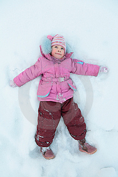 Little Girl Lying On Snow Royalty Free Stock Photography - Image: 8633217