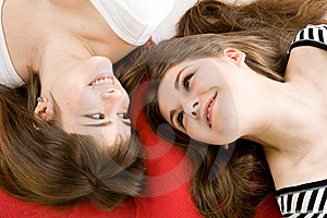 Two Girls Lying On Red Pillow Royalty Free Stock Photography - Image: 8633437