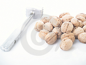 Walnuts And Hammer Stock Photography - Image: 8634572