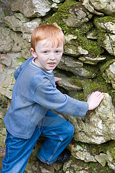 Boy Starting To Climb Old Brick Wall Royalty Free Stock Image - Image: 8637146