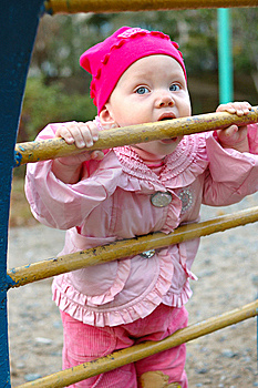 Pretty Little Girl On Child's Playground. Royalty Free Stock Image - Image: 8637236