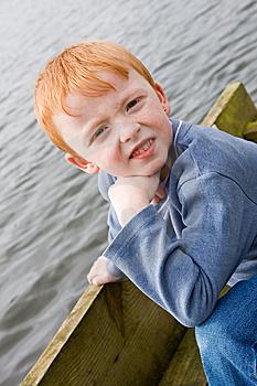 Boy On The Edge Of A Jetty Stock Photo - Image: 8637390