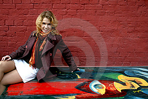 Happy Girl Sitting Near Graffiti Stock Photos - Image: 8638103