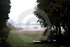 An Old Boat On The Lake  In A Rainy Day Stock Photography - Image: 8638332