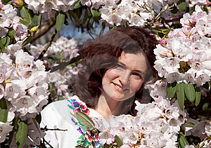 Smiling Girl In Flowering Bush Royalty Free Stock Photo - Image: 8639625