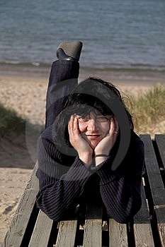 Happy Woman Resting On A Bench On The Beach. Royalty Free Stock Image - Image: 8641696