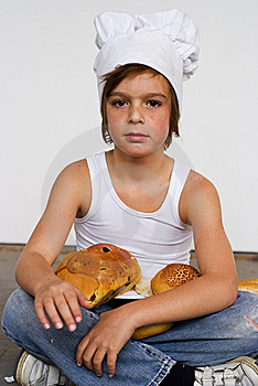 Young Baker Boy And Bread Royalty Free Stock Images - Image: 8641959