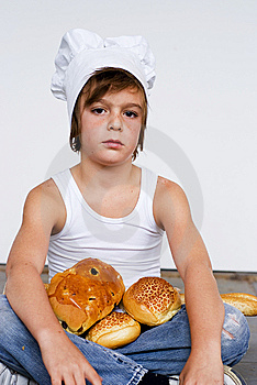 Young Baker Boy And Bread Royalty Free Stock Photography - Image: 8642037