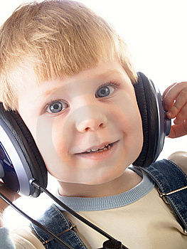 The Child In Headphones Royalty Free Stock Photography - Image: 8646617