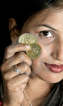 Girl With Coins Stock Photo - Image: 8648250