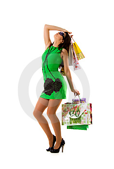 Pretty Woman In Green And Bags Stock Photography - Image: 8648592