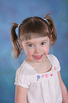Toddler On Blue Background Royalty Free Stock Photography - Image: 8650167