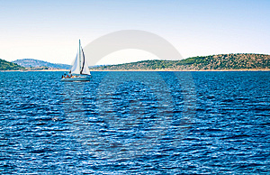 A Sailboat And Deep Blue Sea Royalty Free Stock Photography - Image: 8653027