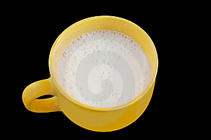 Fresh Milk In Big Yellow Cup On Black Background. Stock Photos - Image: 8654383