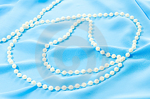 Blue Silk Texture And Pearls Royalty Free Stock Images - Image: 8660399