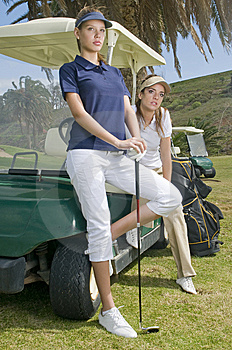 Beautiful Golf Players In Their Golf Cars Stock Images - Image: 8661994