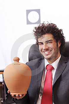 Businessman In The Office With Moneybox Stock Photography - Image: 8667612