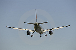 Airplane Is Landing At Airport Stock Photos - Image: 8667703