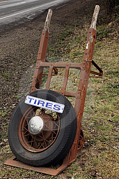 Antique Equipment And Tire With Sign For Business Stock Image - Image: 8671201