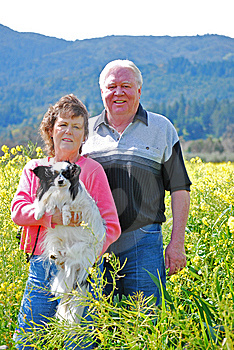 Portrait Of A Happy Couple With Their Dog Stock Photography - Image: 8675332