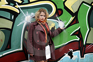 Girl Standing In Front Of A Graffiti Wall Stock Photo - Image: 8679200