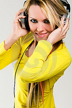 Attractive Young Woman With Headphones Over White Royalty Free Stock Photography - Image: 8697087