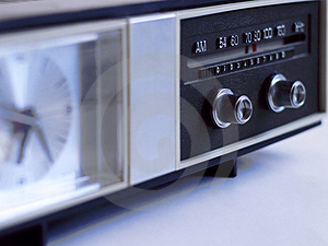 Vintage analog clock radio with radio dial in focus