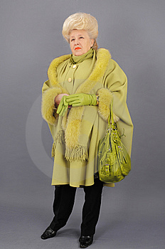 The Woman In A Green Coat. Royalty Free Stock Photography - Image: 8709097