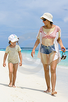 Daughter And Mother Walking On The Beach Stock Photography - Image: 8713262