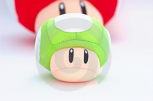 Green Plush Mushroom With Red At The Back On White Royalty Free Stock Photo - Image: 8714475