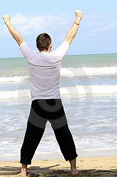 Man doing sport on the beach Royalty Free Stock Image
