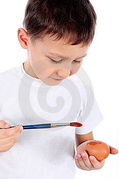 Boy Painting Easter Egg Stock Images - Image: 8722554